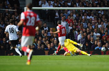 LONDON, ENGLAND - MAY 22:   Robin Van Persie of Arsenal scores during the Barclays Premier League match between Fulham and Arsenal at Craven Cottage on May 22, 2011 in London, England.  (Photo by Clive Mason/Getty Images)