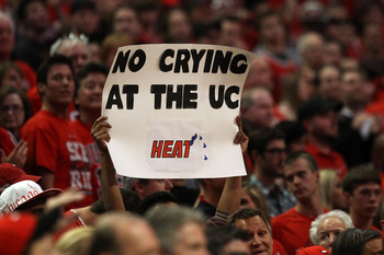CHICAGO, IL - MAY 15:  A fan of the Chicago Bulls holds up a sign which reads 'No Crying at the UC Heat' against the Miami Heat in Game One of the Eastern Conference Finals during the 2011 NBA Playoffs on May 15, 2011 at the United Center in Chicago, Illi