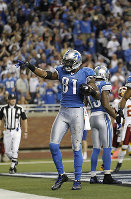 DETROIT - OCTOBER 31:  Calvin Johnson #81 of the Detroit Lions celebrates after scoring a touchdown during the fourth quarter of the game against the Washington Redskins at Ford Field on October 31, 2010 in Detroit, Michigan. The Lions defeated the Redski