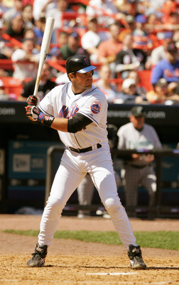 FLUSHING, NY - APRIL 16:  Mike Piazza #31 of the New York Mets bats against the Florida Marlins during the game at Shea Stadium on April 16, 2005 in Flushing, New York. The Mets won 4-3. (Photo by Ezra Shaw /Getty Images)