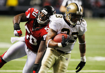 ATLANTA, GA - DECEMBER 27:  Pierre Thomas #23 of the New Orleans Saints runs past Atlanta Falcons defender Curtis Lofton #50 in the second half during their game at the Georgia Dome on December 27, 2010 in Atlanta, Georgia.  (Photo by Scott Halleran/Getty