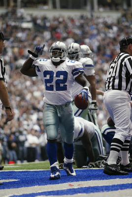 IRVING, TX - OCTOBER 27:   Running Back Emmitt Smith #22 of the Dallas Cowboys celebrates beating the NFL rushing record  during the NFL game against the Seattle Seahawks at Texas Stadium on October 27, 2002 in Irving, Texas. The Seahawks defeated the Cow