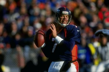 6 Dec 1998: Quarterback John Elway #7 of the Denver Broncos in action during the game against the Kansas City Chiefs at Mile High Stadium in Denver, Colorado. The Broncos defeated the Chiefs 35-31.