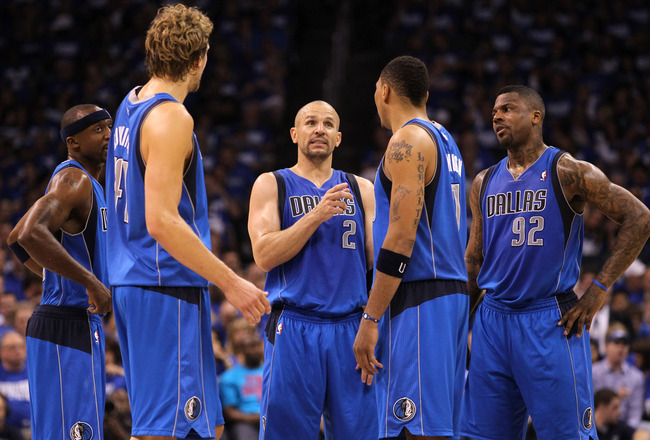 OKLAHOMA CITY, OK - MAY 21:  (C) Jason Kidd #2 of the Dallas Mavericks talks with teammates Jason Terry #31, Dirk Nowitzki #41, Shawn Marion #0 and DeShawn Stevenson #92 while taking on the Oklahoma City Thunder in Game Three of the Western Conference Fin