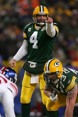 GREEN BAY, WI - JANUARY 20:  Quarterback Brett Favre #4 of the Green Bay Packers points during the third quarter of the NFC championship game against the New York Giants on January 20, 2008 at Lambeau Field in Green Bay, Wisconsin.  (Photo by Jonathan Fer