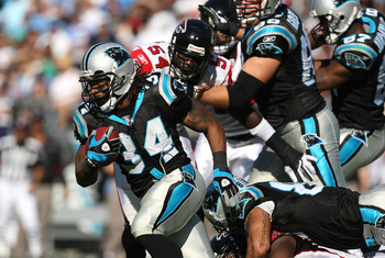 CHARLOTTE, NC - NOVEMBER 15:  DeAngelo Williams #34 of the Carolina Panthers runs with the ball against the Atlanta Falcons during their game at Bank of America Stadium on November 15, 2009 in Charlotte, North Carolina.  (Photo by Streeter Lecka/Getty Ima