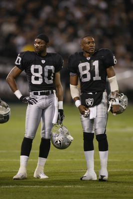 OAKLAND, CA - NOVEMBER 17:  Jerry Rice #80 and Tim Brown #81 of the Oakland Raiders stand on the field during the game against the New England Patriots on November 17, 2002 at Network Associates Coliseum in Oakland, California. The Raiders defeated the Pa
