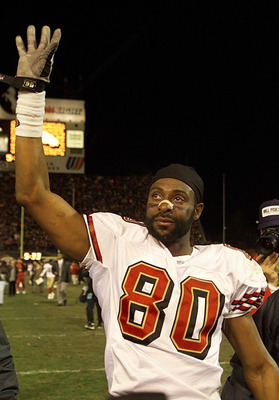 23 Dec 2000: Jerry Rice #80 of the San Francisco 49ers waves as he sheds a tear, in perhaps his final game as a 49er, at the end of the game against the Denver Broncos at Mile High Stadium in Denver, Colorado.  The Broncos won 38-9.  DIGITAL IMAGE. Mandat
