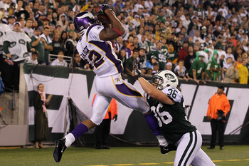 EAST RUTHERFORD, NJ - OCTOBER 11:  Percy Harvin #12 of  the Minnesota Vikings scores an 11-yard touchdown reception against Jim Leonhard #36 of the New York Jets at New Meadowlands Stadium on October 11, 2010 in East Rutherford, New Jersey.  (Photo by Jim
