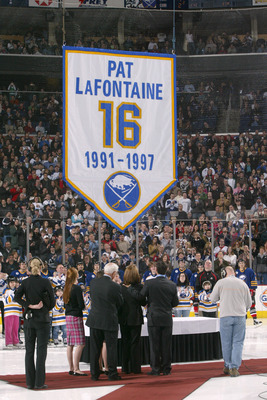 BUFFALO, NY - MARCH 3: Pat LaFontaine and his family watch as his jersey is raised to the rafters during a ceremony to retire his #16 with the Buffalo Sabres before their game against the Toronto Maple Leafs at HSBC Arena March 3, 2006 in Buffalo, New Yor