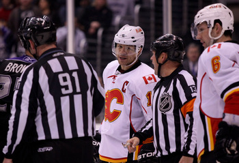 LOS ANGELES, CA - MARCH 21:  Jarome Iginla #12 of the Calgary Flames listens to referee Dan O'Halloran during their NHL game against the Los Angeles Kings at Staples Center on March 21, 2011 in Los Angeles, California. The Kings defeated the Flames 2-1 in