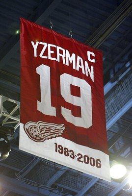DETROIT - JANUARY 2:  Steve Yzerman's Detroit Red Wings #19 is raised to the rafters prior to the Anaheim Ducks taking on the Detroit Red Wings during their NHL game at Joe Louis Arena January 2, 2007 in Detroit, Michigan.  (Photo by Dave Sandford/Getty I