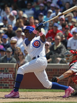 CHICAGO, IL - MAY 08: Alfonso Soriano #12 of the Chicago Cubs hits the ball against the Cincinnati Reds at Wrigley Field on May 8, 2011 in Chicago, Illinois. The Reds defeated the Cubs 2-0. (Photo by Jonathan Daniel/Getty Images)