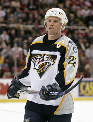 DETROIT - MARCH 21: Greg Johnson #22 of the Nashville Predators skates during the game against the Detroit Red Wings on March 21, 2006 in Detroit, Michigan. Nashville won the game 3-2 in a overtime shootout. (Photo By Gregory Shamus/Getty Images)