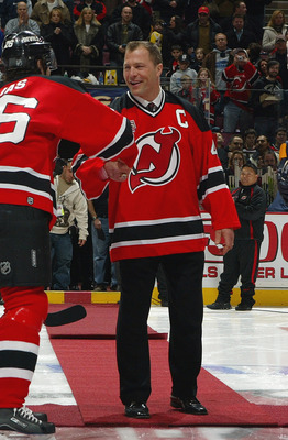 EAST RUTHERFORD, NJ - FEBRUARY 3:  Fomer defenseman Scott Stevens of the New Jersey Devils shakes hands with Patrik Elias #26 prior to the game against the Buffalo Sabres during their game on February 3, 2007 at Continental Airlines Arena in East Rutherfo