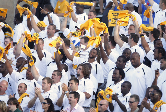 CANTON, OH - AUGUST 7: Members of the Pittsburgh Steelers wave the Terrible Towels as Dick LeBeau is introduced during the 2010 Pro Football Hall of Fame Enshrinement Ceremony at the Pro Football Hall of Fame Field at Fawcett Stadium on August 7, 2010 in