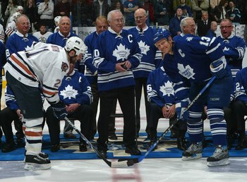 TORONTO - FEBRUARY 17:  George Armstrong drops the ceremonial opening faceoff to Jason Smith #21 of the Edmonton Oilers and Mats Sundin #13 of the Toronto Maple Leafs at Air Canada Centre on February 17, 2007 in Toronto, Ontario, Canada. The Maple Leafs h