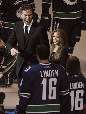 VANCOUVER, CANADA - DECEMBER 17: Trevor Linden (L), formerly of the Vancouver Canucks smiles and laughs at former teammates and friends wearing #16 jerseys bearing his name at General Motors Place December 17, 2008 in Vancouver, British Columbia, Canada.