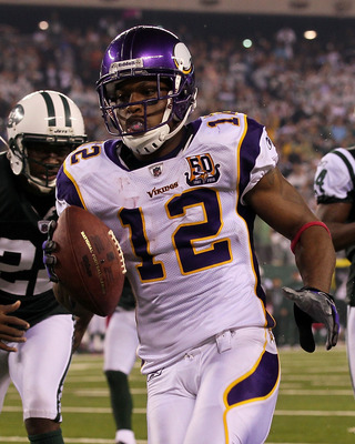EAST RUTHERFORD, NJ - OCTOBER 11:  Percy Harvin #12 of the Minnesota Vikings scores a 34-yard touchdown reception in the fourth quarter against the New York Jets at New Meadowlands Stadium on October 11, 2010 in East Rutherford, New Jersey.  (Photo by Jim
