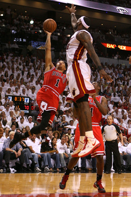 MIAMI, FL - MAY 22:  Derrick Rose #1 of the Chicago Bulls drives for a shot attempt against LeBron James #6 of the Miami Heat in Game Three of the Eastern Conference Finals during the 2011 NBA Playoffs on May 22, 2011 at American Airlines Arena in Miami,