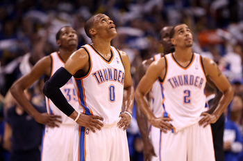 OKLAHOMA CITY, OK - MAY 21:  (C) Russell Westbrook #0 of the Oklahoma City Thunder looks on in the second half while taking on the Dallas Mavericks in Game Three of the Western Conference Finals during the 2011 NBA Playoffs at Oklahoma City Arena on May 2