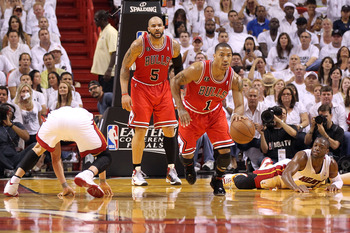 MIAMI, FL - MAY 22:  Derrick Rose #1 of the Chicago Bulls pushes the ball up court against Dwyane Wade #3 (R) and Mike Bibby #0 (L) of the Miami Heat in Game Three of the Eastern Conference Finals during the 2011 NBA Playoffs on May 22, 2011 at American A