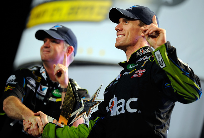 CHARLOTTE, NC - MAY 21:  Carl Edwards, driver of the #99 Aflac Ford, celebrates in victory lane with crew chief Bob Osborne after winning the NASCAR Sprint All-Star Race at Charlotte Motor Speedway on May 21, 2011 in Charlotte, North Carolina.  (Photo by