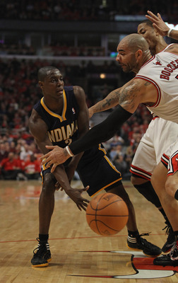 CHICAGO, IL - APRIL 16: Darren Collison #2 of the Indiana Pacers passes the ball against Carlos Boozer #5 and Derrick Rose #1 of the Chicago Bulls in Game One of the Eastern Conference Quarterfinals in the 2011 NBA Playoffs at the United Center on April 1