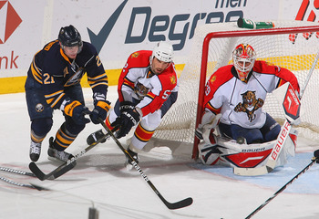 BUFFALO, NY - MARCH 25: Tomas Vokoun #29 and Jason Garrison #52 of the Florida Panthers defend against Drew Stafford #21 of the Buffalo Sabres at HSBC Arena on March 25, 2011 in Buffalo, New York.  (Photo by Rick Stewart/Getty Images)
