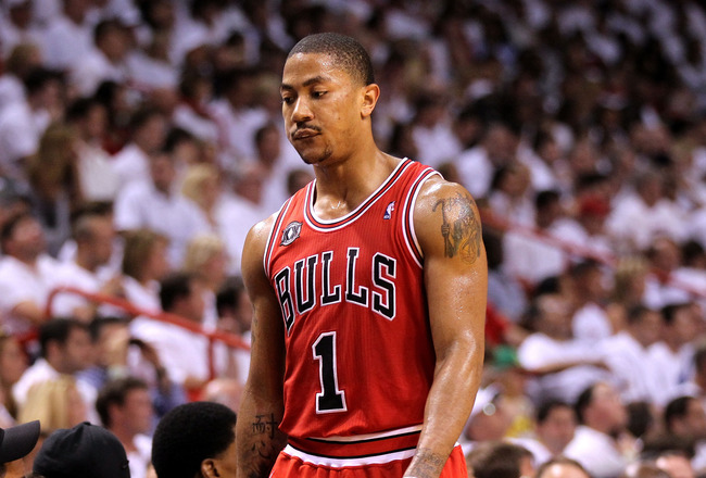 MIAMI, FL - MAY 22:  Derrick Rose #1 of the Chicago Bulls walks back to the bench against the Miami Heat in Game Three of the Eastern Conference Finals during the 2011 NBA Playoffs on May 22, 2011 at American Airlines Arena in Miami, Florida.  NOTE TO USE