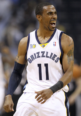MEMPHIS, TN - APRIL 23:  Mike Conley #11 of the  Memphis Grizzles celebrates during the game against the San Antonio Spurs in Game three of the Western Conference Quarterfinals in the 2011 NBA Playoffs at FedExForum on April 23, 2011 in Memphis, Tennessee