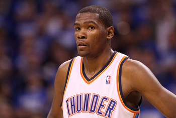 OKLAHOMA CITY, OK - MAY 21:  Kevin Durant #35 of the Oklahoma City Thunder looks on while taking on the Dallas Mavericks in Game Three of the Western Conference Finals during the 2011 NBA Playoffs at Oklahoma City Arena on May 21, 2011 in Oklahoma City, O