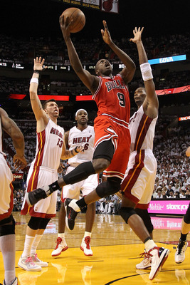 MIAMI, FL - MAY 22:  Luol Deng #9 of the Chicago Bulls drives for a shot attempt against Chris Bosh #1 of the Miami Heat in Game Three of the Eastern Conference Finals during the 2011 NBA Playoffs on May 22, 2011 at American Airlines Arena in Miami, Flori