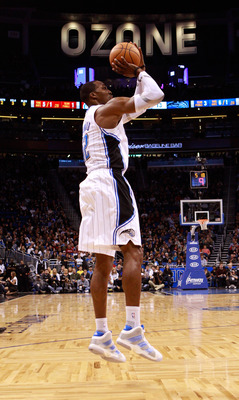 ORLANDO, FL - FEBRUARY 08:  Dwight Howard #12 of the Orlando Magic attempts a shot during the game against the Los Angeles Clippers at Amway Arena on February 8, 2011 in Orlando, Florida.  NOTE TO USER: User expressly acknowledges and agrees that, by down
