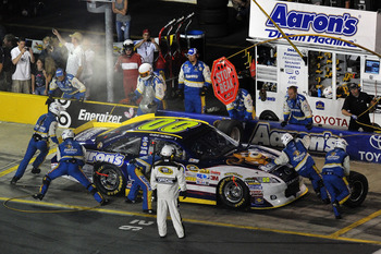 CHARLOTTE, NC - MAY 21:  David Reutimann, driver of the #00 Aaron's Dream Machine Toyota, makes a pit stop during the NASCAR Sprint All-Star Race at Charlotte Motor Speedway on May 21, 2011 in Charlotte, North Carolina.  (Photo by Drew Hallowell/Getty Ima