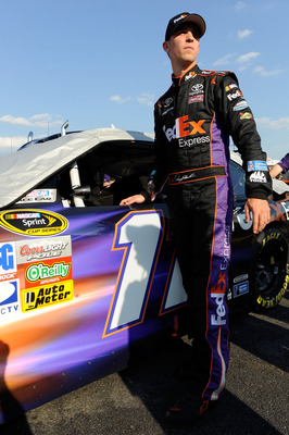 CHARLOTTE, NC - MAY 20:  Denny Hamlin, driver of the #11 FedEx Express Toyota, looks on during qualifying for the NASCAR Sprint All-Star Race at Charlotte Motor Speedway on May 20, 2011 in Charlotte, North Carolina.  (Photo by John Harrelson/Getty Images