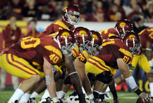 LOS ANGELES, CA - OCTOBER 30:  Matt Barkley #7 of the USC Trojans lines up against the Oregon Ducks at Los Angeles Memorial Coliseum on October 30, 2010 in Los Angeles, California.  (Photo by Harry How/Getty Images)