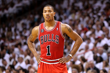 MIAMI, FL - MAY 22:  Derrick Rose #1 of the Chicago Bulls looks on against the Miami Heat in Game Three of the Eastern Conference Finals during the 2011 NBA Playoffs on May 22, 2011 at American Airlines Arena in Miami, Florida.  NOTE TO USER: User express