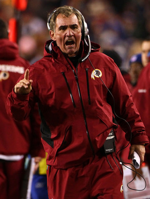 LANDOVER, MD - JANUARY 02: Washington Redskins head coach Mike Shanahan makes a point with a referee in the fourth quarter of a game against the New York Giants at FedEx Field on January 2, 2011 in Landover, Maryland. The Giants won the game 17-14.  (Phot