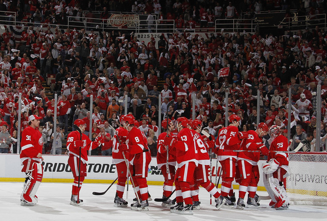 DETROIT, MI - APRIL 16:  Jimmy Howard #35 of the Detroit Red Wings celebrates a 4-3 victory over the Phoenix Coyotes with teammates after Game Two of the Western Conference Quarterfinals during the 2011 Stanley Cup Playoffs at Joe Louis Arena on April 16,