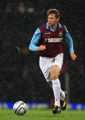 LONDON, ENGLAND - NOVEMBER 30:  Jonathan Spector of West Ham United in action during the Carling Cup Quarter Final match between West Ham United and Manchester United at the Boleyn Ground on November 30, 2010 in London, England.  (Photo by Mark Thompson/G