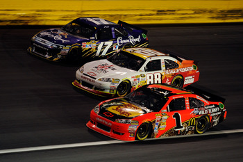 CHARLOTTE, NC - MAY 21:  Jamie McMurray, driver of the #1 Bass Pro Shops/NWTF Chevrolet, races Dale Earnhardt Jr., driver of the #88 Dale Jr. Foundation/VH1 Save the Music/Amp Energy Sugar-Free/National Guard Chevrolet, and Matt Kenseth, driver of the #17