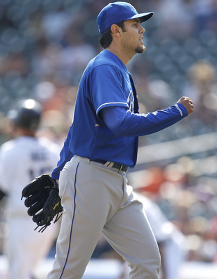 DETROIT, MI - APRIL 10: Joakim Soria #48 of the Kansas City Royals reacts after beating the Detroit Tigers 9-5 at Comerica Park on April 10, 2011 in Detroit, Michigan.  (Photo by Gregory Shamus/Getty Images)