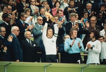 7 Jul 1974:  Franz Beckenbauer (centre) of Germany becomes the first Captain to lift the new FIFA trophy after leading his side to victory over Holland in the World Cup Final at the Olympic Stadium in Munich, Germany. Germany won the match 2-1. \ Mandator