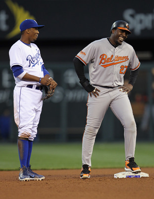 KANSAS CITY, MO - MAY 03:  Alcides Escobar #2 of the Kansas City Royals jokes with Vladimir Guerrero #27 of the Baltimore Orioles during the game on May 3, 2011 at Kauffman Stadium in Kansas City, Missouri.  (Photo by Jamie Squire/Getty Images)