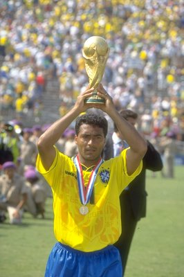 17 Jul 1994:  Romario of Brazil holds the trophy aloft after the World Cup final against Italy at the Rose Bowl in Los Angeles, California, USA. Brazil won the match 3-2 on penalties. \ Mandatory Credit: Simon  Bruty/Allsport