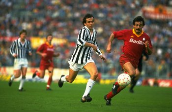 Undated:  Michel Platini (left) of Juventus chases Emidio Oddi of Roma  during an Italian League match at the Olympic Stadium in Rome. Roma won the match 3-0. \ Mandatory Credit: Allsport UK /Allsport