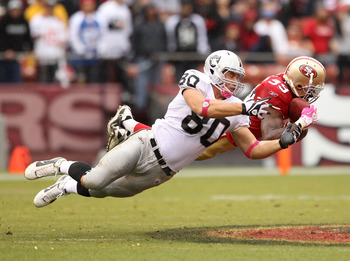 SAN FRANCISCO - OCTOBER 17:  Manny Lawson #99 of the San Francisco 49ers intercepts a pass intended for Zach Miller #80 of the Oakland Raiders at Candlestick Park on October 17, 2010 in San Francisco, California.  (Photo by Ezra Shaw/Getty Images)