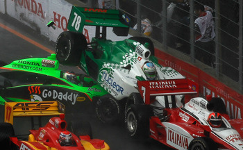 SAO POULO, BRAZIL - MAY 01:  Danica Patrick crashes her #7 GoDaddy.com Andretti Autosport Honda Dallara in to Simona de Silvestro in her #78 Nuclear Clean Air Energy HVM Racing Honda Dallara and Helio Castroneves in his #3 Itaipava Team Penske Dallara Hon