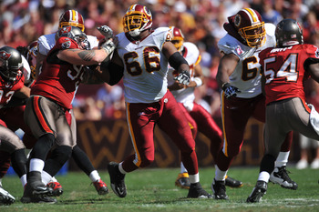 LANDOVER, MD - OCTOBER 4:  Derrick Dockery #66 of the Washington Redskins defends against the Tampa Bay Buccaneers at FedExField on October 4, 2009 in Landover, Maryland. The Redskins defeated the Buccaneers 16-13. (Photo by Larry French/Getty Images)